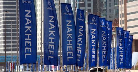 Flags for property company Nakheel are seen on the Sheik Zayed highway in Dubai