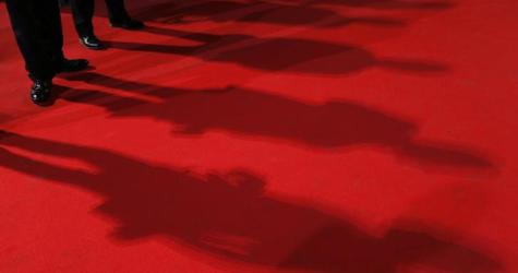 """Photographers cast their shadows on the red carpet during arrivals for the screening of the film """"Timbuktu"""" in competition at the 67th Cannes Film Festival in Cannes"""