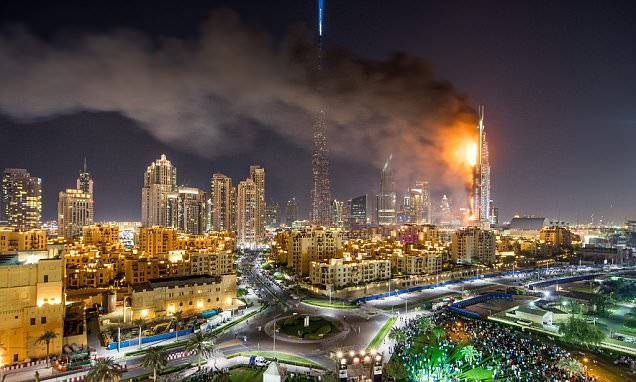 Flames and smoke after a fire broke out at the The Address Hotel in Dubai