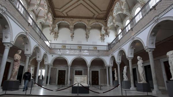 Man walks inside national Bardo museum, in Tunis