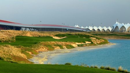 ABU DHABI, UNITED ARAB EMIRATES - JANUARY 26:  A view from the tee on the par 3, 8th hole looking towards the clubhouse and the Yas Island Formula 1 racetrack at Yas Island Golf Club designed by Kyle Phillips of the USA nearing completion on January 26, 2010 in Abu Dhabi, United Arab Emirates.  (Photo by David Cannon/Getty Images)