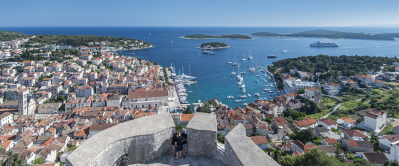 Hvar is a Croatian island in the Adriatic Sea, located off the Dalmatian coast, lying between the islands of Brac, Vis and Korcula. Approximately 68 km (42.25 mi) long, with a high east-west ridge of Mesozoic limestone and dolomite, the island of Hvar is unusual in the area for having a large fertile coastal plain, and fresh water springs. Its hillsides are covered in pine forests, with vineyards, olive groves, fruit orchards and lavender fields in the agricultural areas. The climate is characterized by mild winters, and warm summers with many hours of sunshine. The island has 11,103 residents, making it the 4th most populated of the Croatian islands.