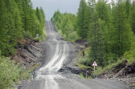 Gravel road at Kolyma state highway Russia outback