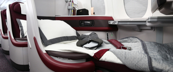 Business class passenger seats sit aboard a Qatar Airways Ltd. Airbus A350 XWB aircraft at the Singapore Airshow held at the Changi Exhibition Centre in Singapore, on Tuesday, Feb. 16, 2016., on Tuesday, Feb. 16, 2016. Qatar Airways, the second-biggest Gulf carrier, will seek compensation for delays in delivery of its Airbus Group SE A320neo aircraft, Chief Executive Officer Akbar Al Baker said. Photographer: SeongJoon Cho/Bloomberg via Getty Images