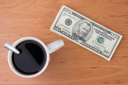 BCFGB7 coffee cup and money on wooden background