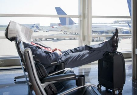 Caucasian businessman napping in airport