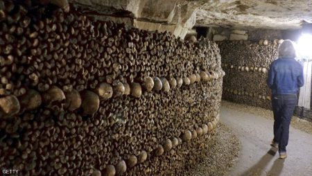 People visit the Catacombs of Paris which hold over six million skulls and bones. These underground quarries were used to store the remains of generations of Parisians in a bid to cope with the overcrowding of Paris' cemeteries at the end of the 18th century, and are now a popular tourist attraction. AFP PHOTO/DOMINIQUE FAGET        (Photo credit should read DOMINIQUE FAGET/AFP/Getty Images)