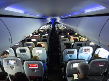Airplane cabin, seats and passengers