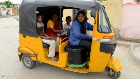 Indian auto rickshaw driver Vennapusa Narayanamma drives passengers in her vehicle in the Nijampet District on the outskirts of Hyderabad on August 3, 2014. Thirty six year old Narayanamma, who earns between Indian Rupees 300-400 (USD 4.90-6.55) per day,  is an un-educated, mother of two children, She has been driving  her vehicle which she purchased with the assistance of an NGO for the last five years, and it provides a means to supplement her family income as well as a safe mode of transport for the working  women of her community.   AFP PHOTO/NOAH SEELAM        (Photo credit should read NOAH SEELAM/AFP/Getty Images)