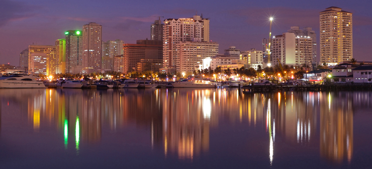 vibrant manila bay city night-scape and buildings reflection.; Shutterstock ID 100414315; PO: CLP Image Gallery Test; Client: Hotels.com; Other: (79)