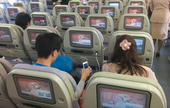 MUNICH, GERMANY - DECEMBER 04: Flight passengers with mobile phone use entertainment program on screens on board of a Airbus A 380 on the way to Myanmar via Dubai at Munich Airport on December 04, 2016 in Munich, Germany. (Photo by EyesWideOpen/Getty Images)